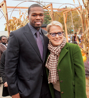 "Bette Midler with the rapper 50 Cent. Prompted by a cleanup effort in her own neighborhood, Midler founded the New York Restoration Project to redevelop ""under-resourced"" parks and community gardens in New York City. Last year, rapper 50 Cent funded NYRP's renovation of a community garden in his childhood neighborhood in Queens. Photo by Johnny Nunez/ WireImage."